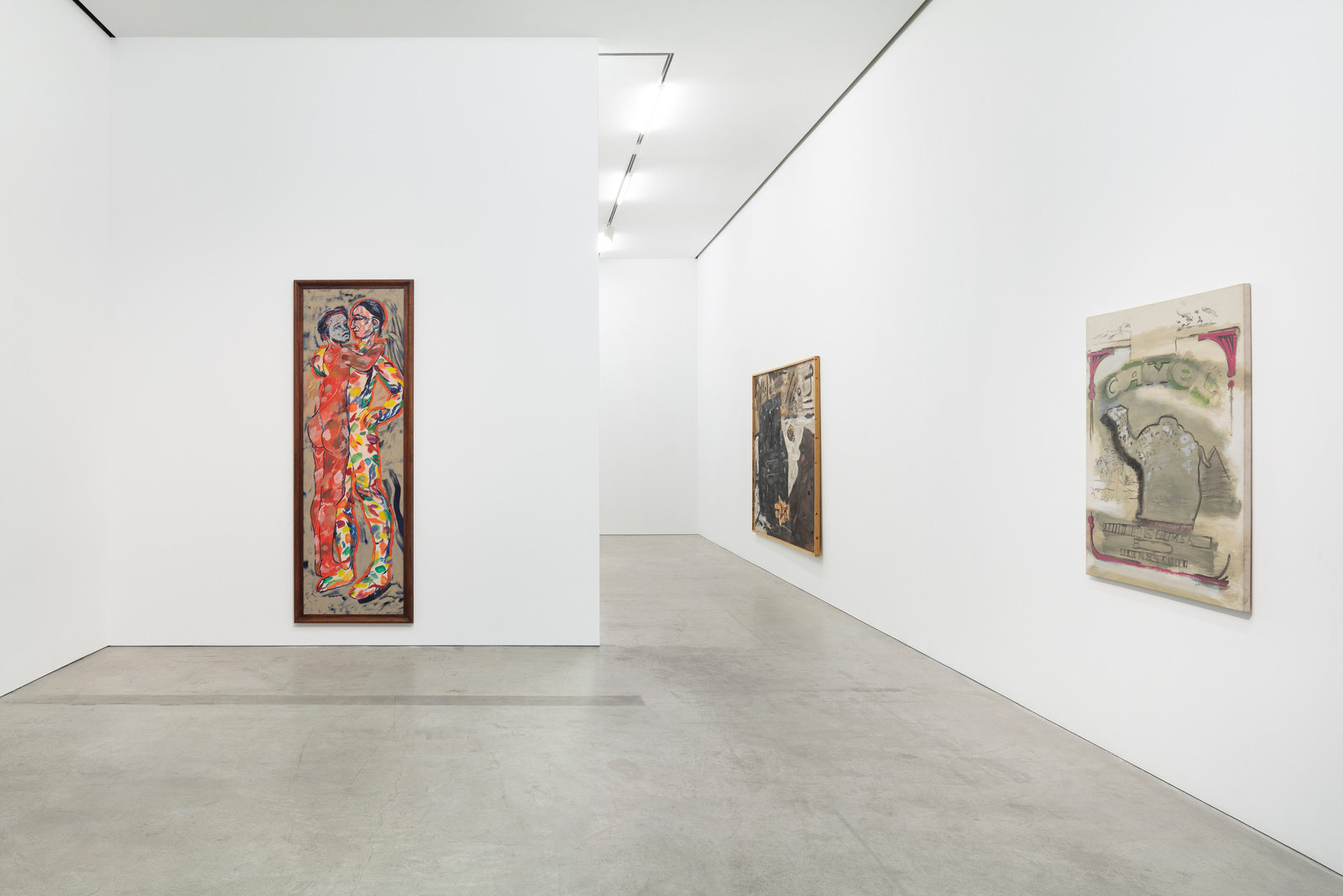 three paintings of different scales hung on the walls. One colorful painting of two figures embracing by RB Kitaj is tall and narrow. The remaining two are more subdued in their palette, by Werner Büttner and Larry Rivers.