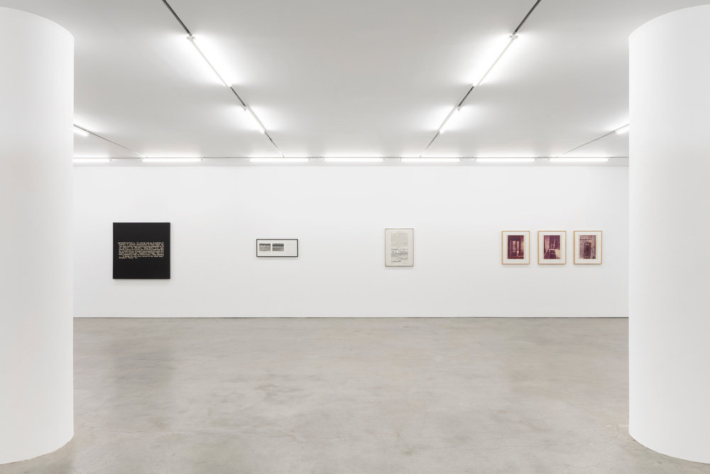 An installation view of four works hung on a gallery wall.