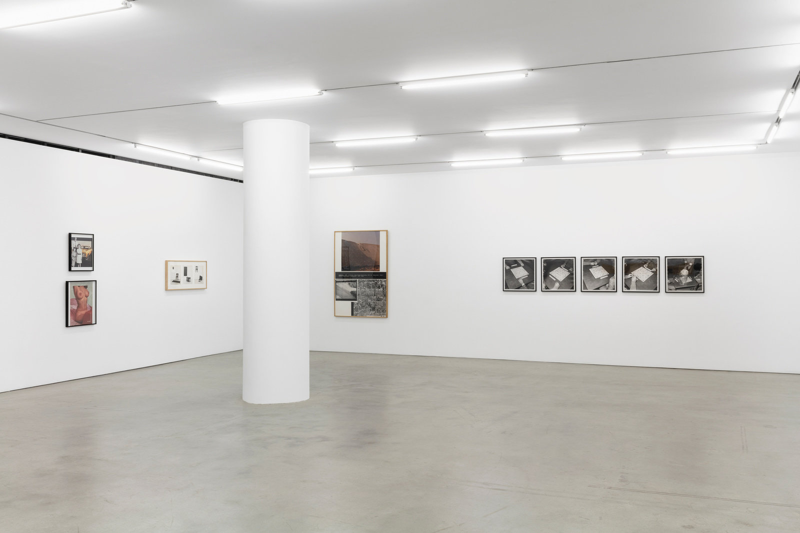 An installation view of four works hung on adjacent gallery walls.