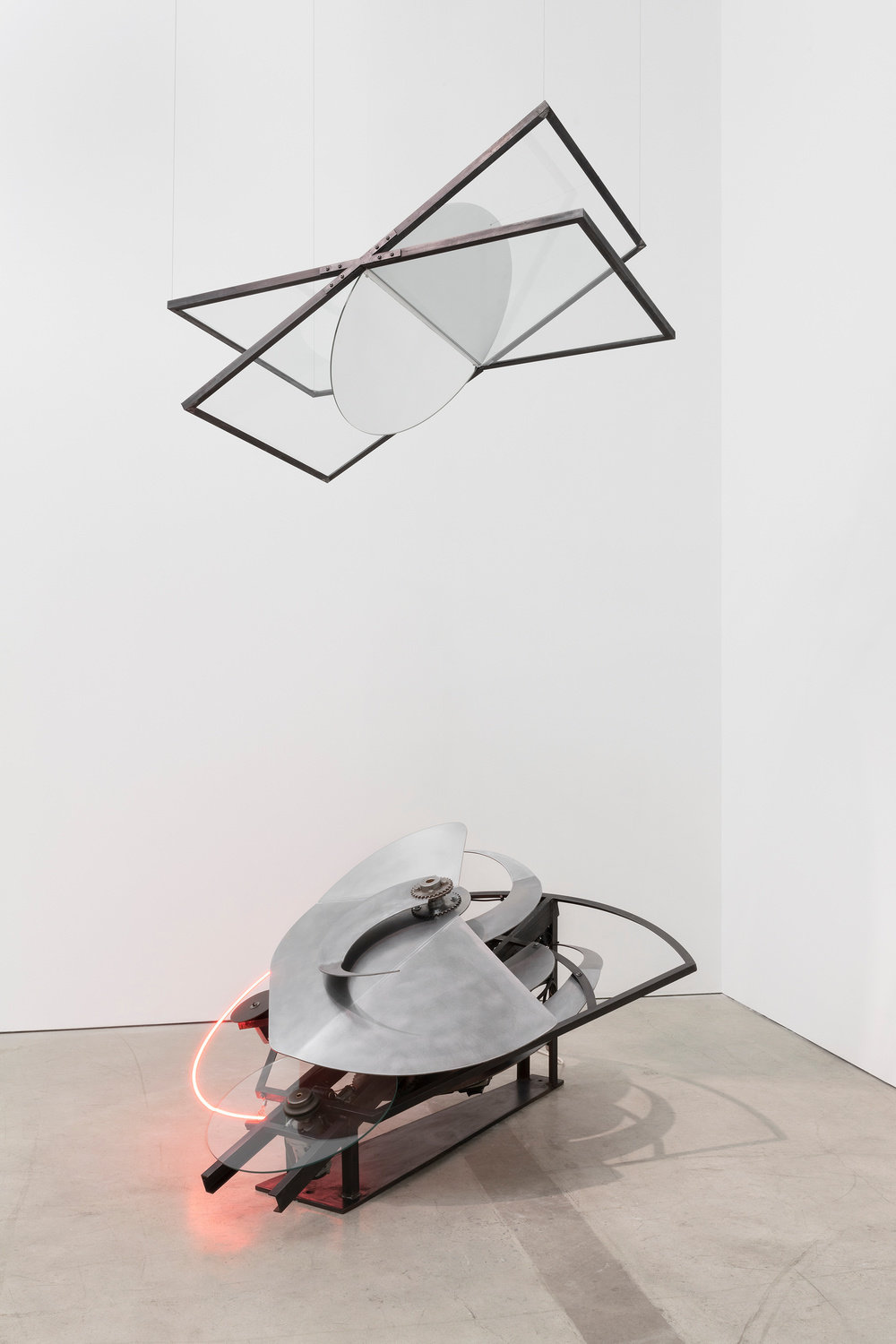 A kinetic sculpture with a neon strip by Alice Aycock