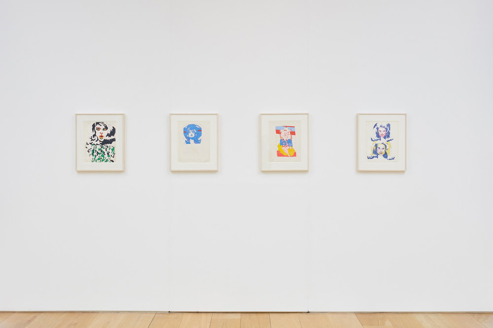 An installation view of four Karl Wirsum framed and color ink works on paper hanging on a wall horizontally.