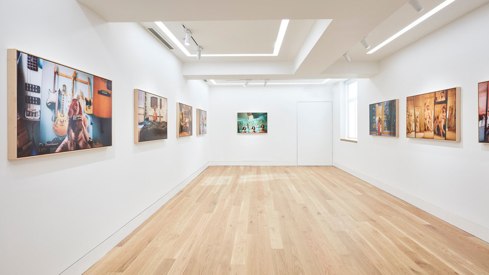 An installation view of Ryan McGinley photographs on the gallery walls.