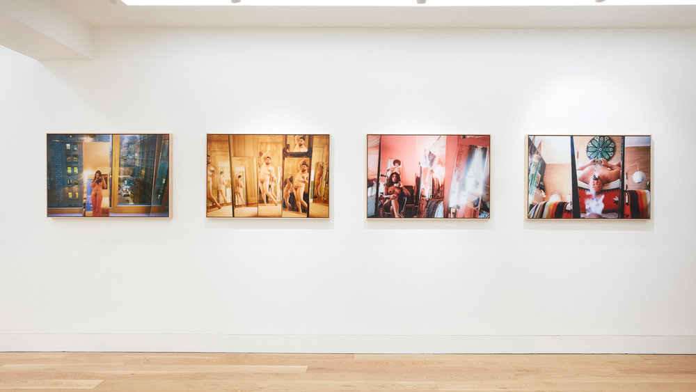 An installation view of four Ryan McGinley photographs hung horizontally on the wall.